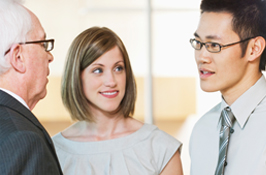 Two co-op students talking to a manager